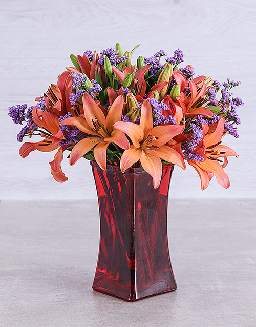 lilies: Sunset Lilies and Latifolia in a Red Square Vase!
