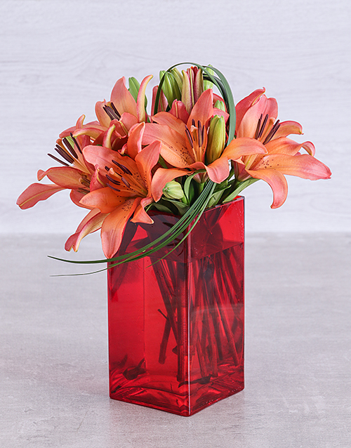 vase: Sunset Lilies and Leriopi in a Red Square Vase!