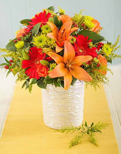 pottery: Orange and Red Flowers in Glazed Vase!