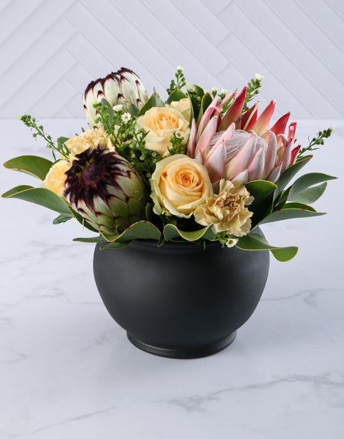 sympathy: Graceful Rose and Protea Arrangement!