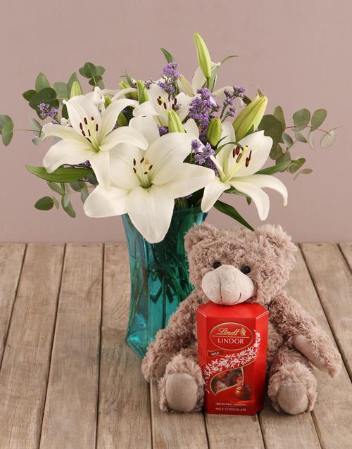 teachers-day: White Asiflorum Lilies in Blue Vase!