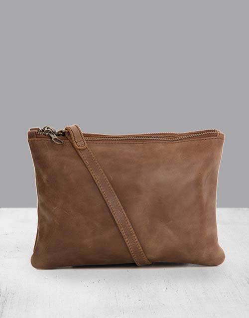 apparel: Zemp Paddington Waxy Tan Sling Bag!