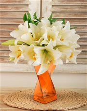 Picture of St Joseph Lilies in a Orange Twisty Vase!