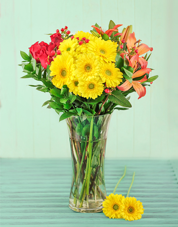 Picture of Vase of Orange and Yellow Seasonal Flowers!