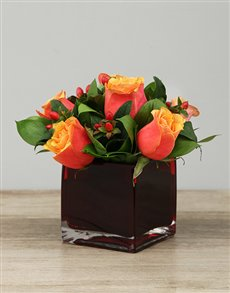 flowers: Roses and Hypericum in Red Square Vase!