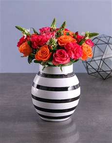 flowers: Delicate Flower Delights In Striped Vase!