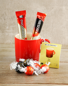gifts: Le Creuset and Treats Hamper!