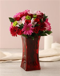 flowers: Blushing Love Arrangement In Red Vase!