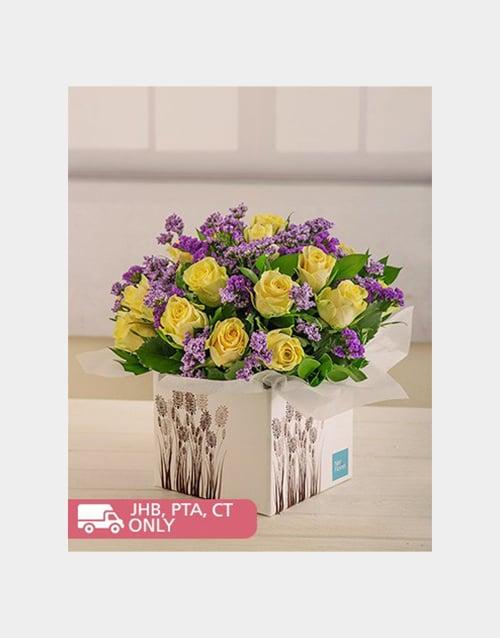 colour: Cream Roses and Purple Filler in Box!