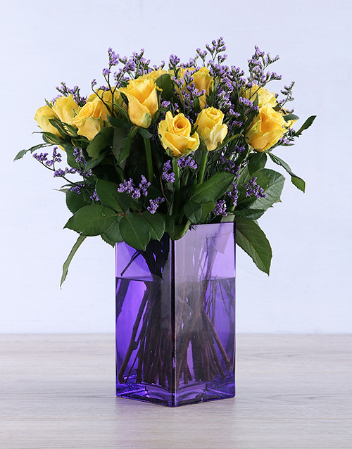 colour: Yellow Roses in a delightful purple vase!
