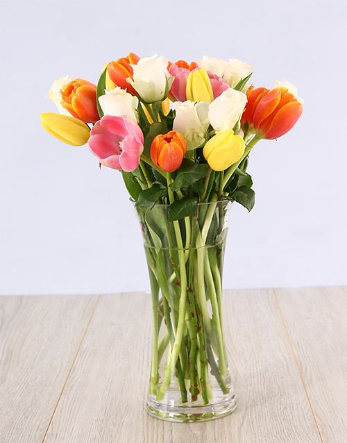 Mixed Tulips And White Roses In A Glass Vase Online