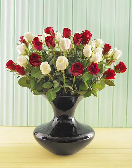 Red And White Roses In A Black Elegant Vase Online